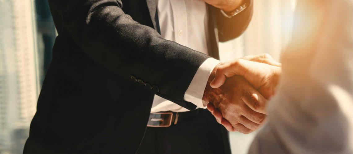 business background of businessman having handshake